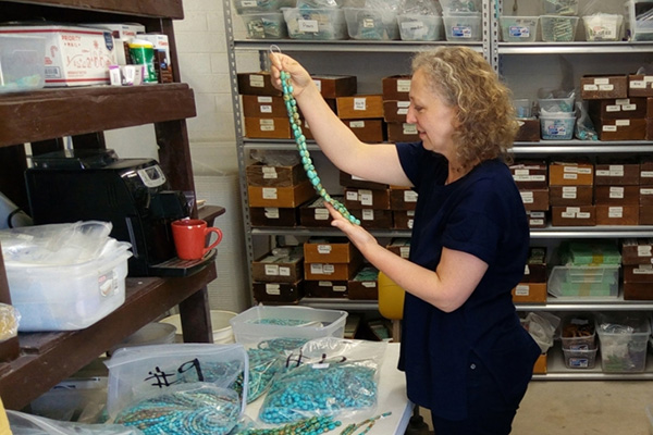 Kamila inspecting the jewelry