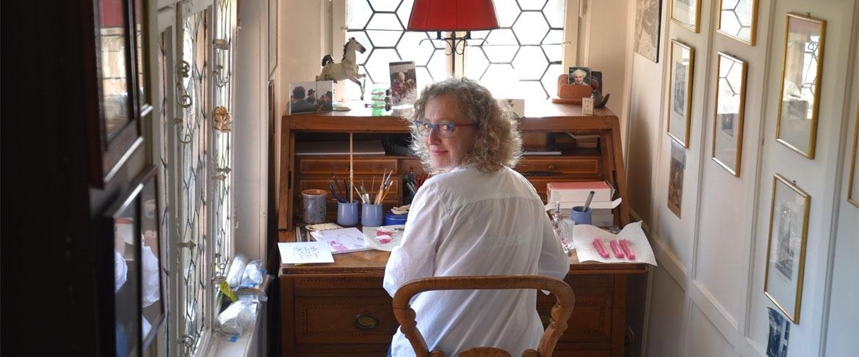 Kamila working in her office