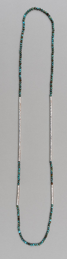 A necklace with two pairs of hammered 925 silver tubes of different length combined with turquoise boulder rounds