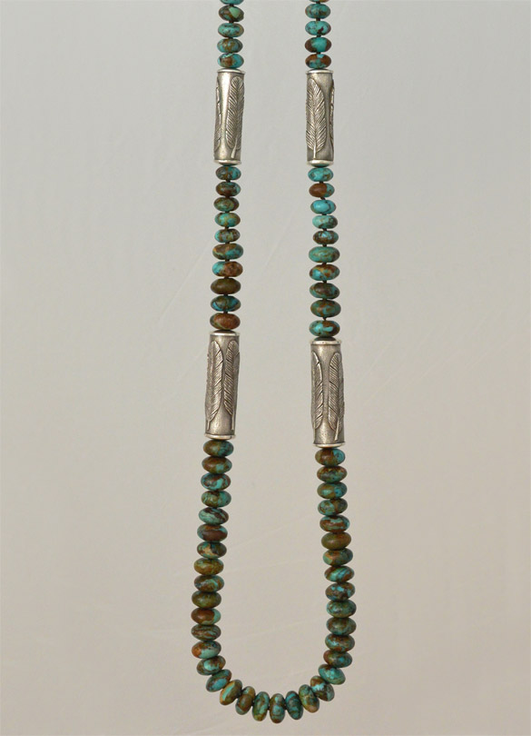 Old World cast 925 silver cylinders bearing feathers on necklace of Arizona Boulder turquoise rondelles, from jewelry collections by Kamila Kubelik, inspired by visits to the American Southwest