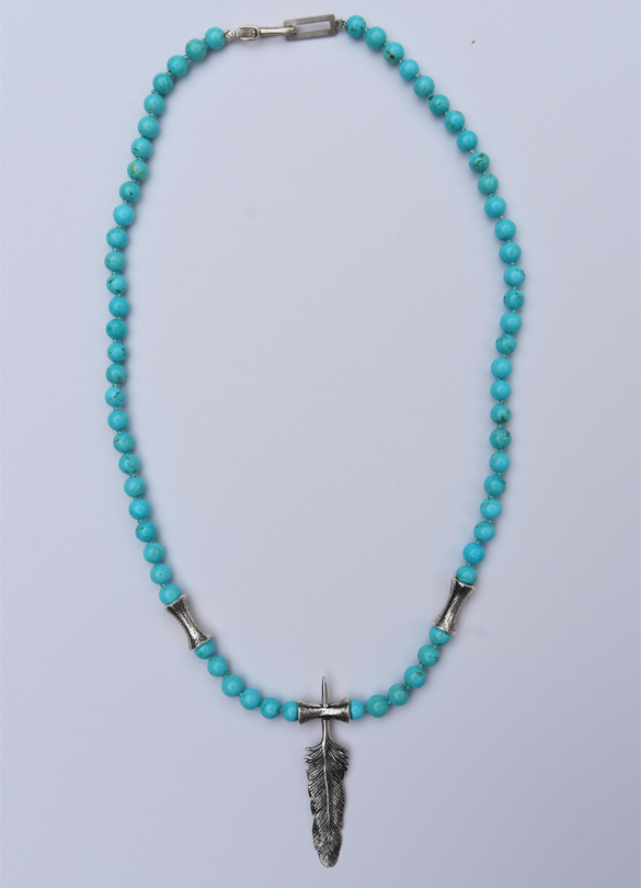A single feather and flute motif in 925 cast silver as center piece of a necklace with a combinated of Ag 925 flutes and Arizona turquoise rounds