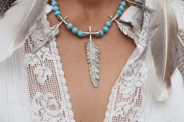 Five 925 cast silver differently sized feather and flute motifs combined with Arizona turquoise rounds